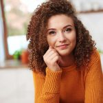 portrait-of-smiling-young-woman-6H5U2GA.jpg